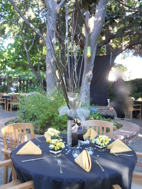 Class reunion table decor with flowers and ribbon to match school colors
