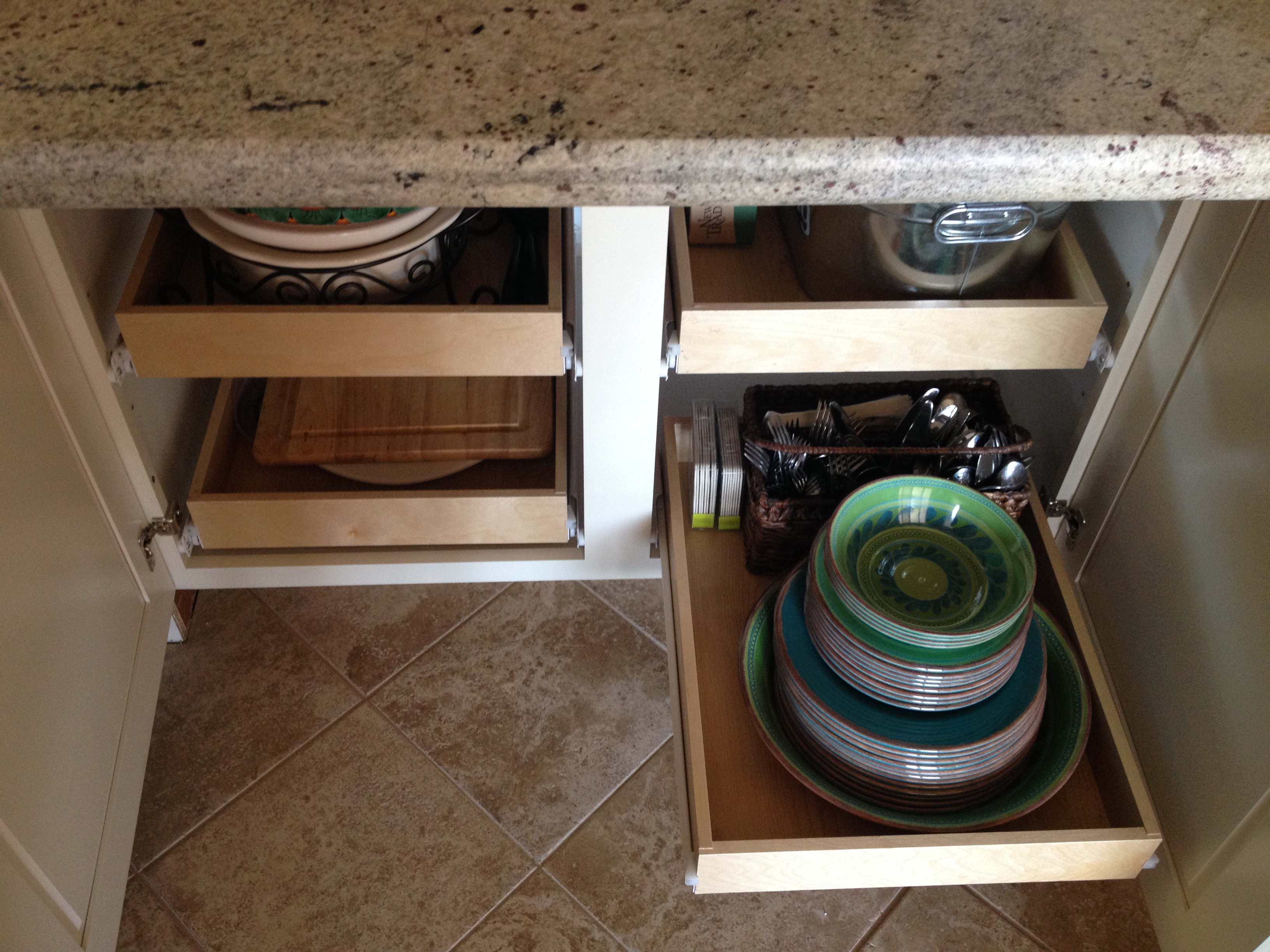 Organize your kitchen: Roll-out trays under countertop overhang at back of island | inspiredhaven.com