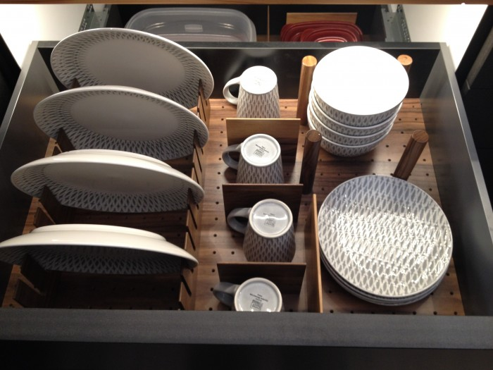It's much easier to see what's in the drawer with in-cabinet lighting. Hafele booth, KBIS 2015
