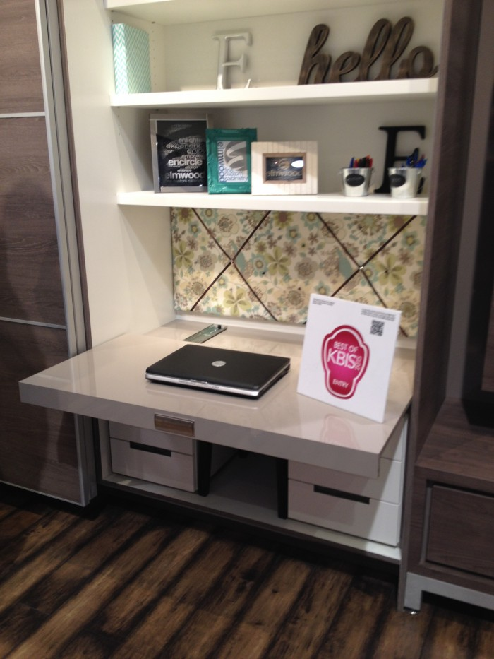 Concealed work space behind automatic sliding door, Elmwood Cabinets at #KBIS 2015