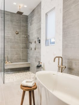 Master bath with freestanding tub and zero entry /curbless shower