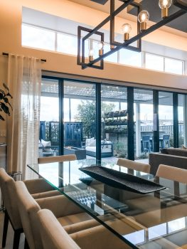 Outdoors in dining space, black sliding door, modern transitional