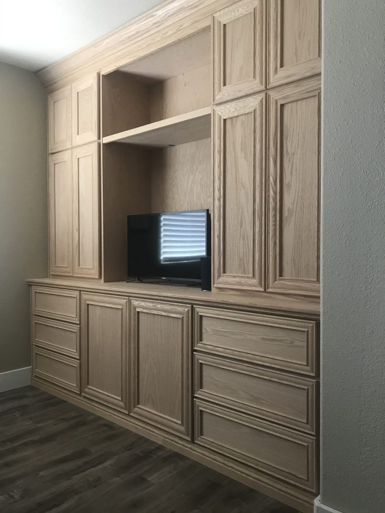 Built-in office cabinets in unfinished oak