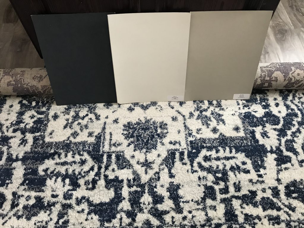 Cream and navy area rug with color palette