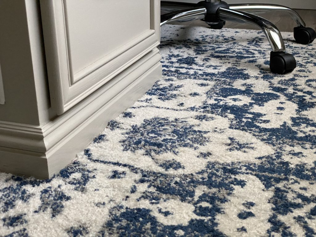 Blue and Cream Rug cut around built in desk