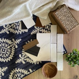 Flat lay with blue rug showing vertical offset subway tile